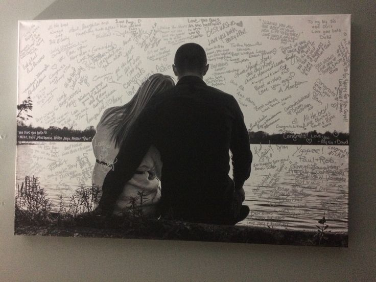 We made our wedding guest book into a large black and white canvas of an engagement photo! Everybody wrote their well wishes with a silver sharpie and it's perfect for our home!