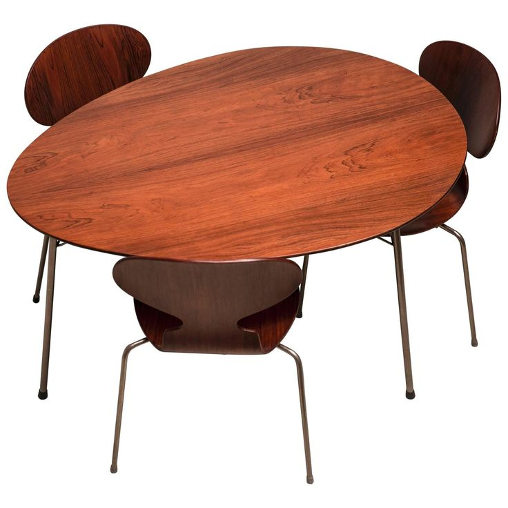This is the shape for the kids table(s) made out of the doors!!! Exceptional Early Brazilian Rosewood Egg Table and Ant Chairs by Arne Jacobsen | From a unique collection of antique and modern dining room tables at https://www.1stdibs.com/furniture/tables/dining-room-tables/