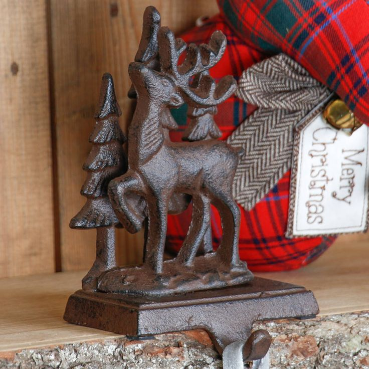 £15 cast iron reindeer stocking holder hook by dibor | notonthehighstreet.com