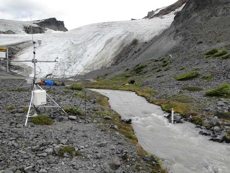 Sholes Glacier exhibiting lack of snowcover on August 7, 2015.  Stream gage and weather station in foreground. A disastrous year is unfolding in 2015 for North Cascade glaciers, if normal melt conditions continue the range will lose 5-7% of its entire glacier volume in one year! For the 32nd consecutive year we were in the North Cascade Range, of Washington to observe the mass balance of glaciers across the entire …