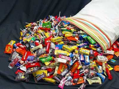 Using our pillowcase to go trick-or-treating on Halloween. I always came home with it full of candy (as well as a few pennies, popcorn balls and an apple or two)!