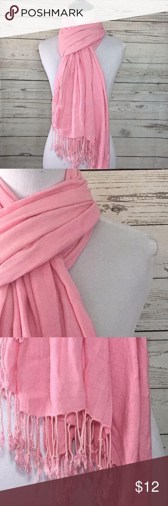 Pink Scarf with Tassles This pink scarf is really soft and has tassles It was never worn and was purchased at a boutique Measurements:  27x72 Accessories Scarves & Wraps