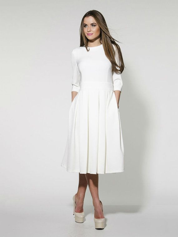 This simple at first glance dress...Elegant white pleated dress knee length,long sleeve and pockets.This model is so comfortable and versatile!Can