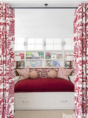 A bedroom built at the top of the staircase. Designed by Ann Wolf. housebeautiful.com #nook #built-in_bed #curtains #red_accents