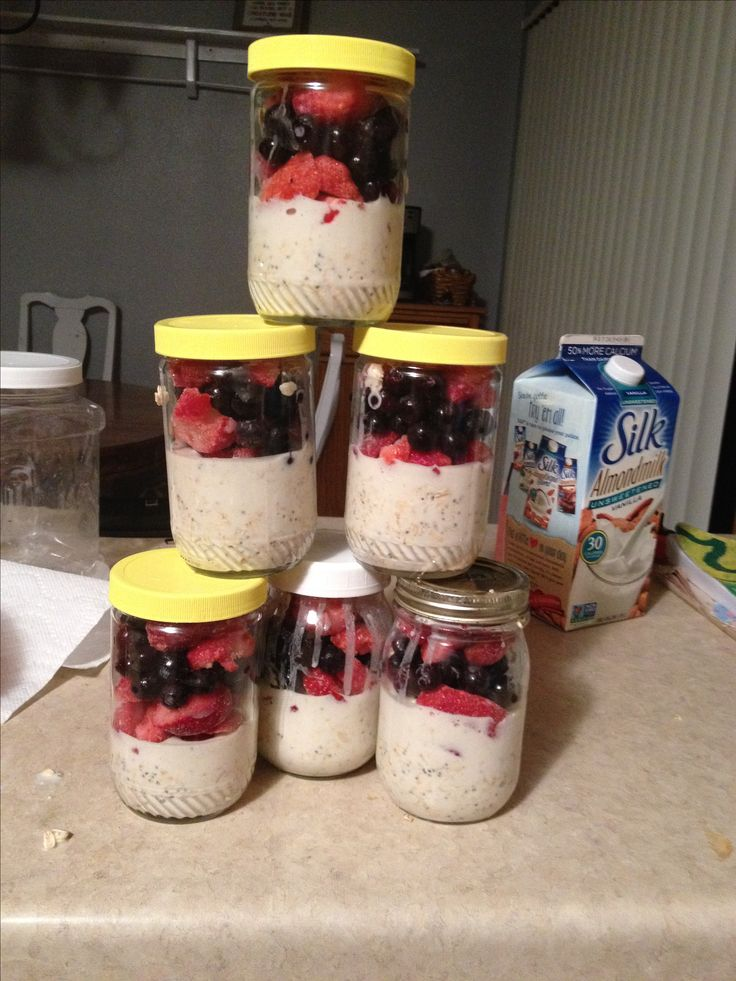 Overnight Oats Parfait! 3 cups Old Fashioned Oats 3 cups unsweetened Almond Milk 1 cup Greek Yogurt 2 TBSP Chia Seeds 1 TBSP THM Sweet Blend 1/8 + 1/4 tsp THM Stevia Mix all ingredients together and divide into 6 jars with a 2/3 cup scoop. Top with 1/2 cup frozen strawberries and 1/4 cup frozen blueberries.  Put in fridge overnight and enjoy!! 5 g Fat, 34g Carbs, 11g Protein.