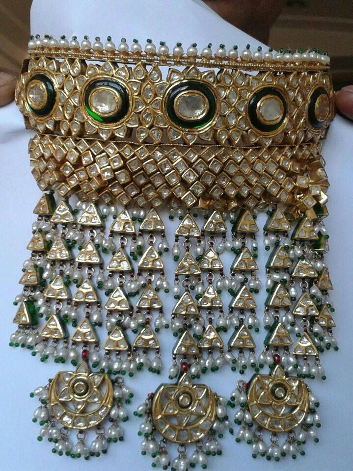 """"""" Aad """" this piece of jewel is worn Rajput Ladies on their wedding day."""