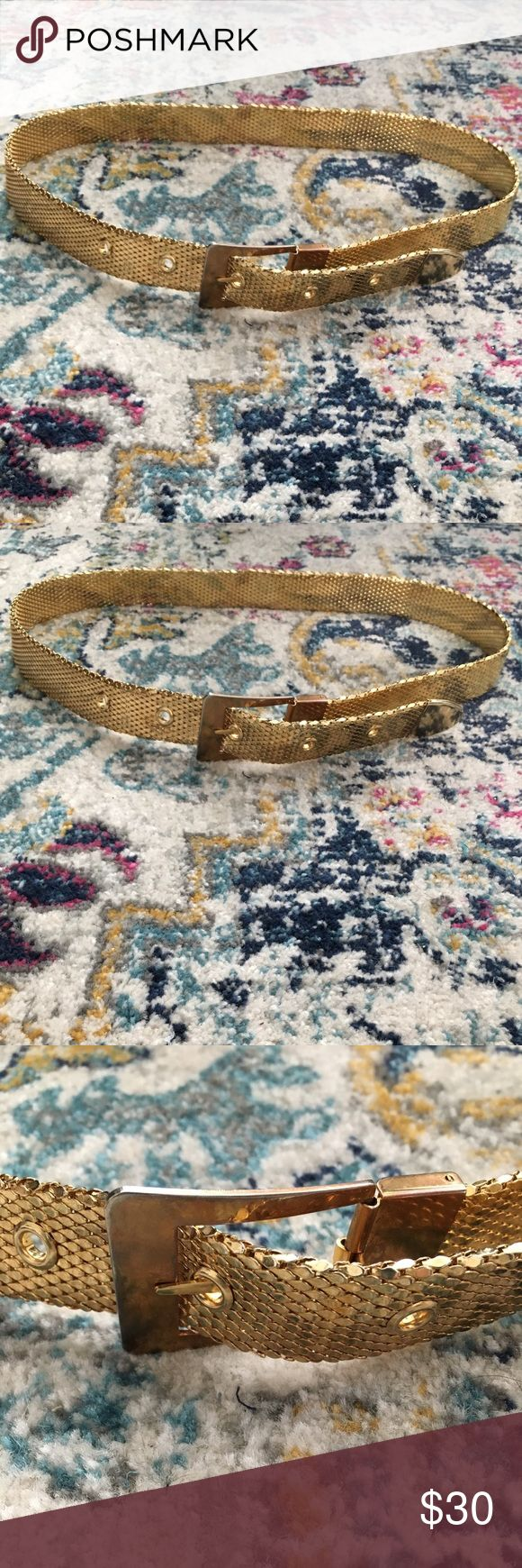 """Vintage Snakeskin Scale Gold Metal Belt M Beautiful vintage piece that needs a new home! Textured metal belt with Snakeskin motif. Rectangular buckle with belt loops for adjusting. Wear over a dress as a fun accent piece or use with your fave jeans! Some turning of color on buckle. Over 36"""" in total length. Labeling as Medium. This could be worn at hip or waist depending on your size. Vintage Accessories Belts"""