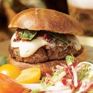 All-American Burger with Red Pepper Relish Top this two-fisted hamburger with a slice of mozzarella cheese, fresh basil leaves, and the red sweet pepper relish.