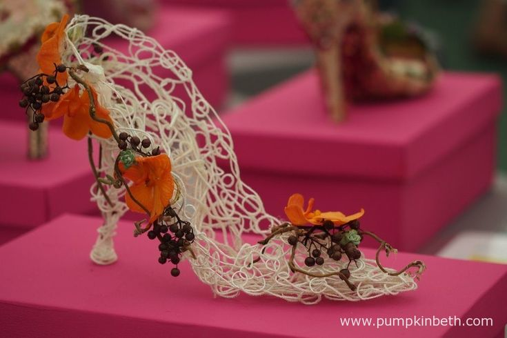 These intricately decorated shoes can be seen in the Surrey NAFAS Floral Display…