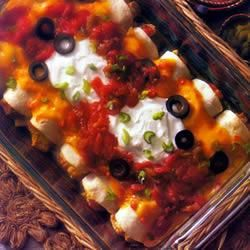 Chicken and Cheese Enchiladas~~Campbell's recipe that I've been using for 15 years.  My hubby's favorite meal for me to make. PLUS!!!!  All 3 kids love it.  What a keeper!