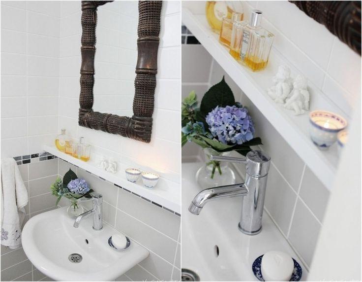 Bilderleiste als Wandregal im Bad über Waschbecken