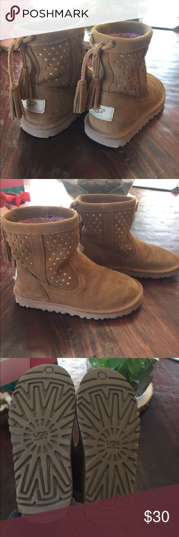 Girls UGG boots Girls UGG boots!! Cutout star detail and tassels on the back. Hardly worn, great condition!! UGG Shoes Boots