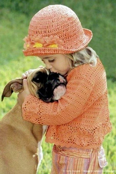 Hugs and kisses. So sweet! Sooo adorable. Don't forget to order your grain free organic dog treats for his stocking! Www.boneyardbakery.net