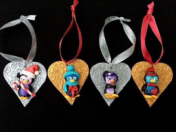 Cute penguin ornaments are handmade by me from polymer clay. Great decoration for your Christmas tree or anywhere in your home! Awesome gift idea! You can choose one of these four penguins by the object they hold (red heart, tiny flower, gift box or candy) or purchase all of them at