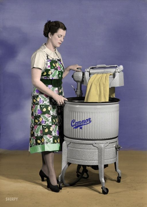 """Through the Wringer (Colorized): 1950  My grandmother Blanche had one of these in her basement in Iowa. Modern washers were available and I believe she had one, but she liked to use this for sheets. As a kid, she """"let"""" me help work it."""