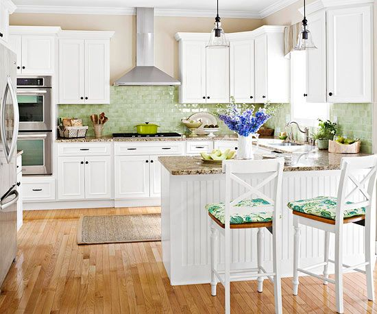A colorful yet subtle backsplash adds personality and charm to this kitchen remodel.
