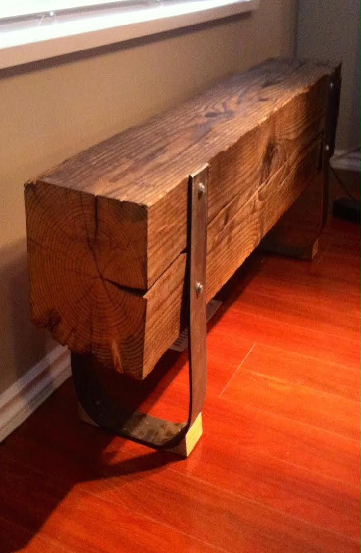 """'Steeling the Beam' - a rad new rustic bench by Tree of Life Furniture.  A salvaged solid fir beam, hand polished to bring out the natural colours of the grain. Custom steel legs accented with wood feet-ures.  91/2""""W x 19""""T x 54""""L"""