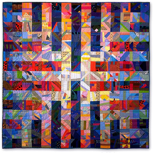 Labyrinth II Quilt by Monica McGregor.  The light colors in the center and the darker, duller ones on the perimeter really make this quilt glow!
