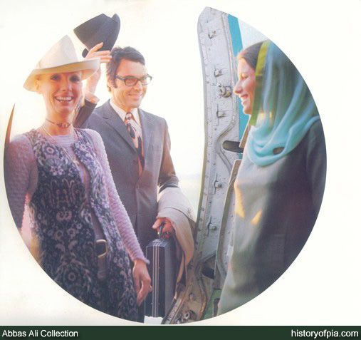 Pakistan International Airlines (PIA) flight attendant welcoming passengers aboard airline's Boeing jetliner in early 1970s. The flight attendant is wearing uniform designed by French fashion designer Pierre Cardin.