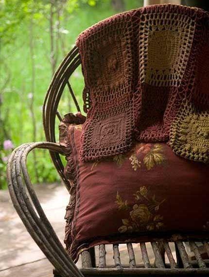 Pretty cushions and crocheted throws.  So cozy.  ~  Dishfunctional Designs: The Bohemian Chair