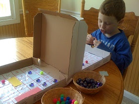Homemade Battleship Game using letters and numbers. Made from pizza boxes. Creative!