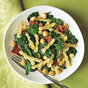 Gemelli with Broccoli Rabe, Bacon, and Chickpeas- 1 pound broccoli, trimmed and coarsely chopped   -8 ounces uncooked gemelli pasta - 6 slices center-cut bacon  - 3    garlic cloves, thinly sliced- 1   (15-ounce) can no-salt-added chickpeas (garbanzo beans), rinsed and drained - 1/2 teaspoon salt
