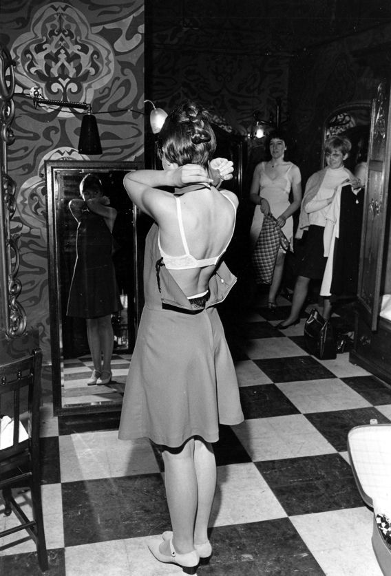 Woman trying on a dress in the changing room at Biba
