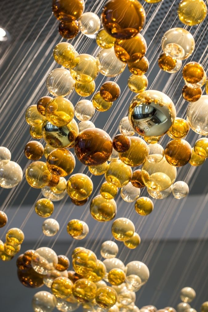 Lighting wave of hand-blown bubbles. Made of warm shades of amber and golden overtones.