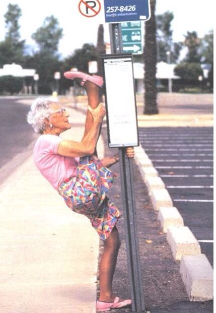 Old woman..leg up on sign