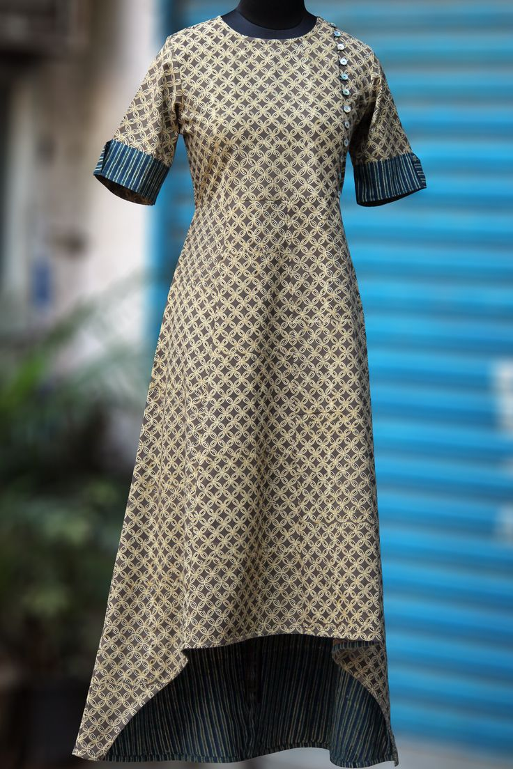 a perfect evening dress with an asymmetrical hemline & mother-of-pearlbuttons on the side. the neck flap can be opened to reveal the indigo & beigel