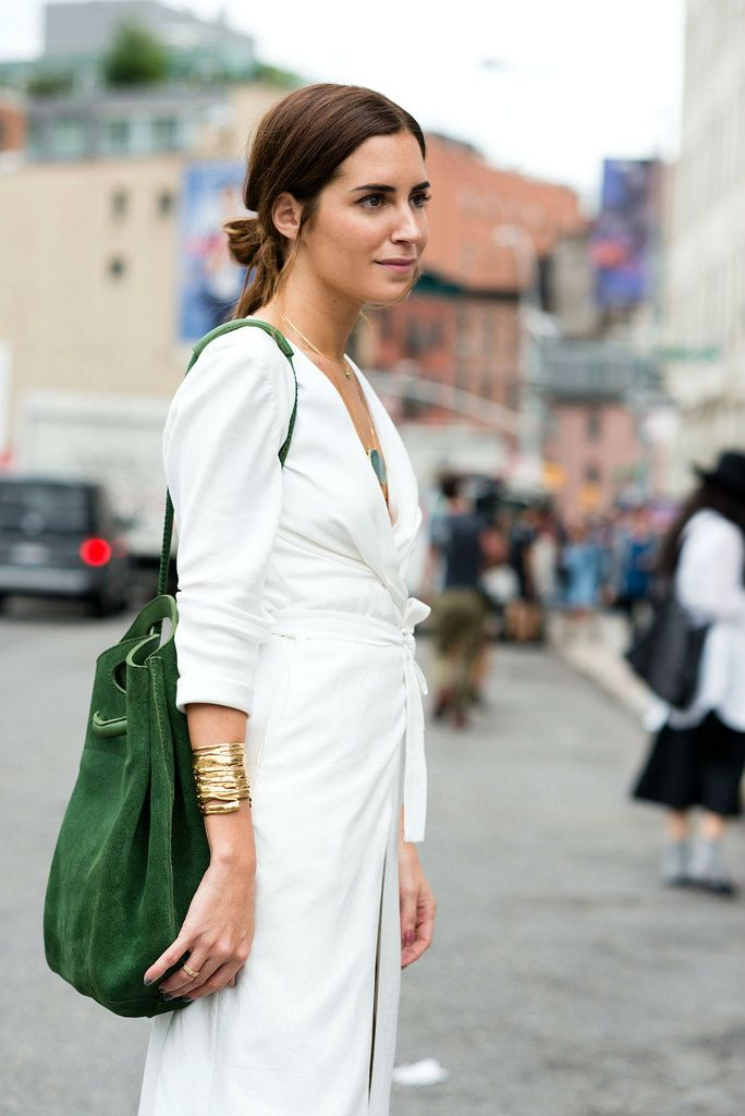 Gala Gonzalez wearing Pedro Garcia Small Drawstring Bucket in green suede at New York Fashion Week.