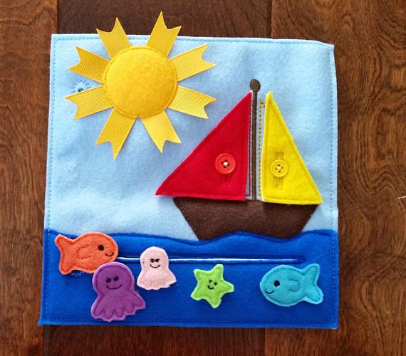 Create a Custom Quiet Book, Busy Book or Busy Bag with a variety of pages, both puzzles and activities available! This listing is for the SAILBOAT PAGE. This cute sailboat has two button on sails. The sun has ribbon rays to add to the texture. A wave pocket holds loose fish for