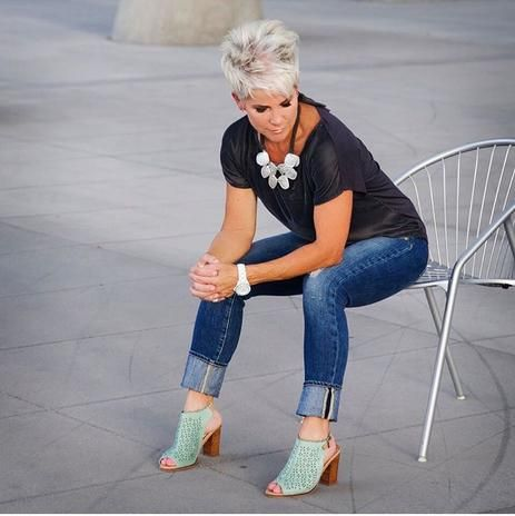I think she is the most beautiful fashion blogger. Hard to believe she's over 50.