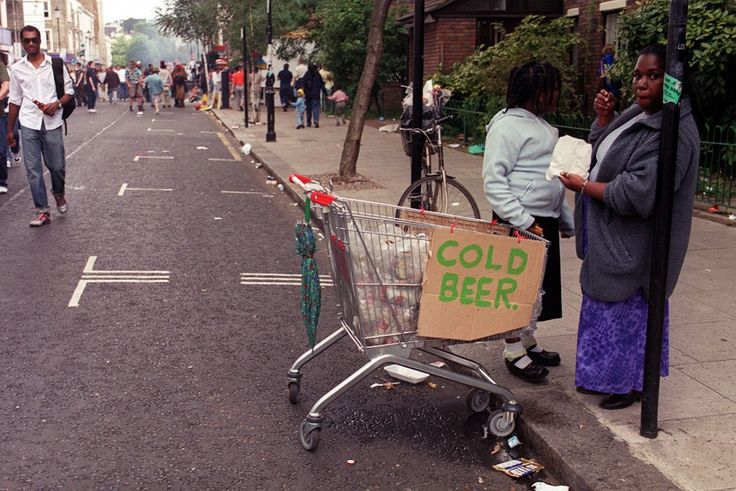 Women with a shopping trolley filled with cold beer at the Notting Hill Carnival 2000 in London. Ref #: PA.1335980  Date: 28/08/2000