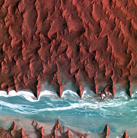 Satellite photo of the Namib desert pictured from space. From the mighty dunes of the Sahara to the intricate skin-like folds of the Arabian...
