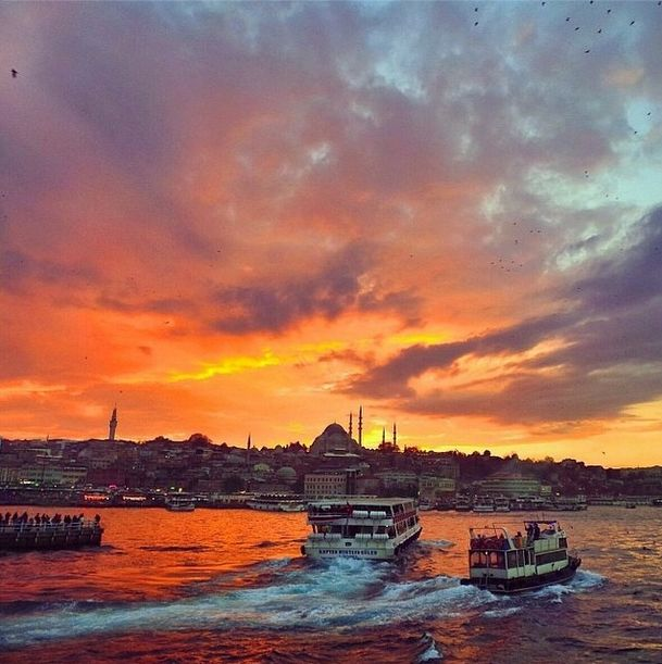 As the sun goes down in İstanbul, it colors the sky in shades of gold.
