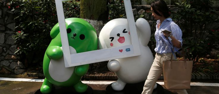 This Chinese tech giant is now worth more than Facebook   A girl walks past WeChat mascots inside TIT Creativity Industry Zone where Tencent office is located in Guangzhou, China May 9, 2017. Picture taken May 9, 2017.     REUTERS/Bobby Yip - RC12AA19C0C0