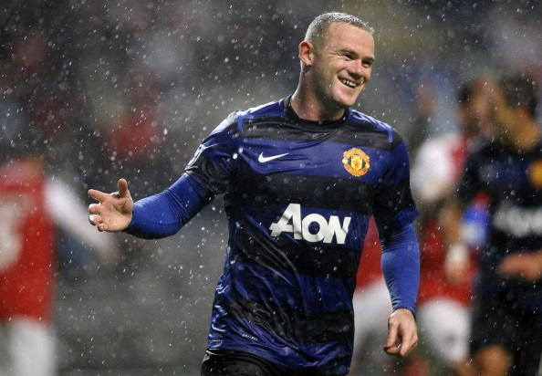 Manchester United's English forward Wayne Rooney celebrates after scoring during the UEFA Champions League football match SC Braga vs Manchester United at the Municipal stadium of Braga on November 7, 2012. Manchester won the match 3-1