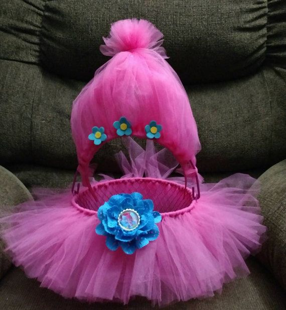 Want to stand out in the crowd at your next Easter egg hunt? Now your princess can have the cutest Easter basket on the block ! Just think, our basket is also perfect for stuffing with hair bows, headbands or other goodies on Easter morning! This Trolls themed basket comes complete with a woven in pink tutu (not removable), a troll hair headband and a troll bottle cap flower clip. What a bargain!   Our tutu baskets make adorable baby shower or birthday party gifts as is -but just think of…
