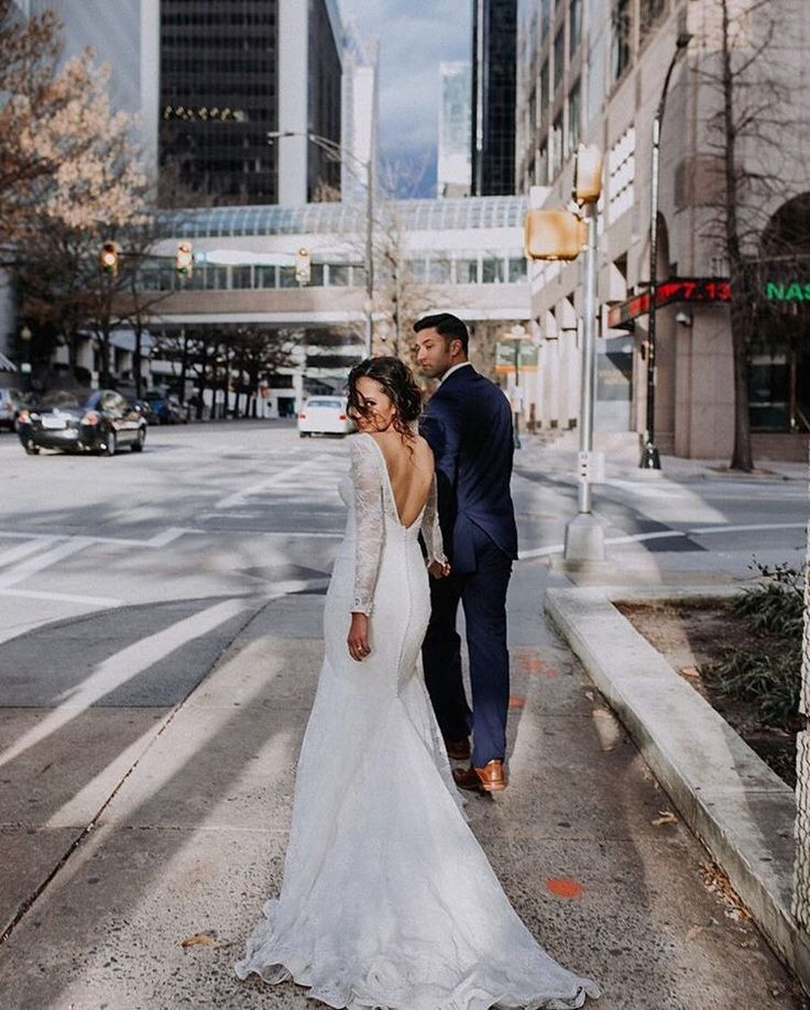 Breanna Rook was absolutely stunning in this long sleeve allover lace trumpet wedding dress by Truly Zac Posen available at David's Bridal | Photo by The Mango Market