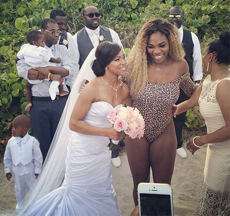Serena Williams smiles with the beachside bride in Miami, Fla. on May 31.