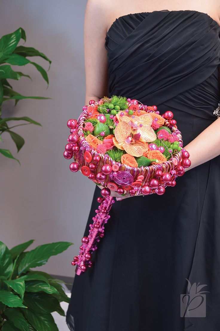 A Color Declaration bouquet created with pink and gold aluminum wire, beaded wire, and button wire. Green ball dianthus, orange and hot pink spray roses, phalaenopsis orchids and pods complement perfectly! | #PennockFloral
