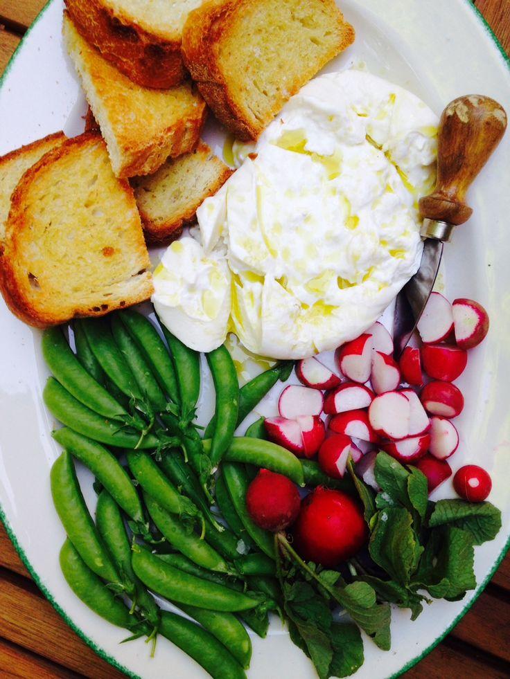 Sugar snaps, radishes, toasts, and burrito showered with olive oil & sea salt.