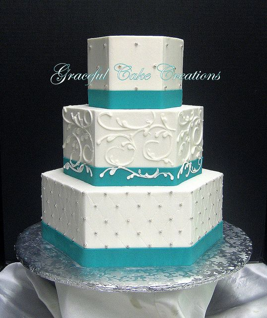 White Butter Cream Hexagon Wedding Cake with Teal Blue Ribbon