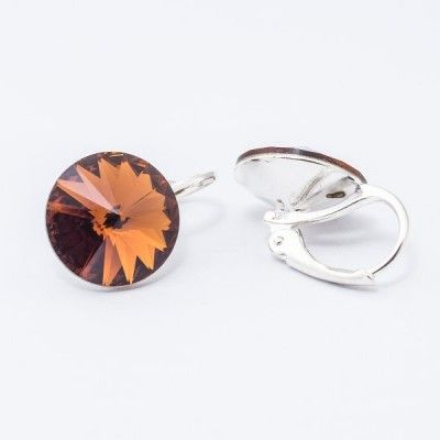Swarovski Rivoli Earrings 12mm Smoked Topaz  Dimensions: length: 1,7cm stone size: 12mm Weight ~ 3,18g ( 1 pair ) Metal : silver plated brass Stones: Swarovski Elements 1122 12mm Colour: Smoked Topaz 1 package = 1 pair Price 16,90 PLN(about 4 EUR)