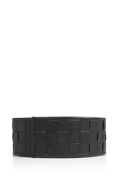 This belt is crafted from the finest quality nappa leather in a unique chessboard weave. The wide, adjustable design elegantly cinches your waist and adds definition to your silhouette. Wear it with anything from floaty dresses to tailored coats.##Lamb nappa leather|Geometrical weave |Adjustable snap closure|Width: 8 cm