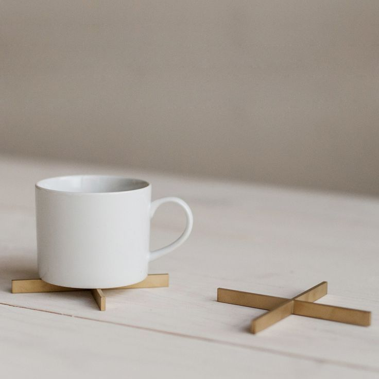 Our new X Coaster is made of solid brass.  Minimal, fun and functional.  Made in the USA by a Seattle-based design studio.