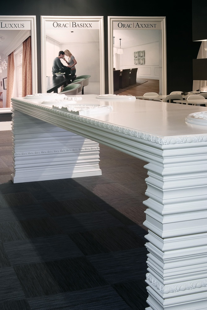 Batimat booth with white glossy table with ORAC DECOR profiles