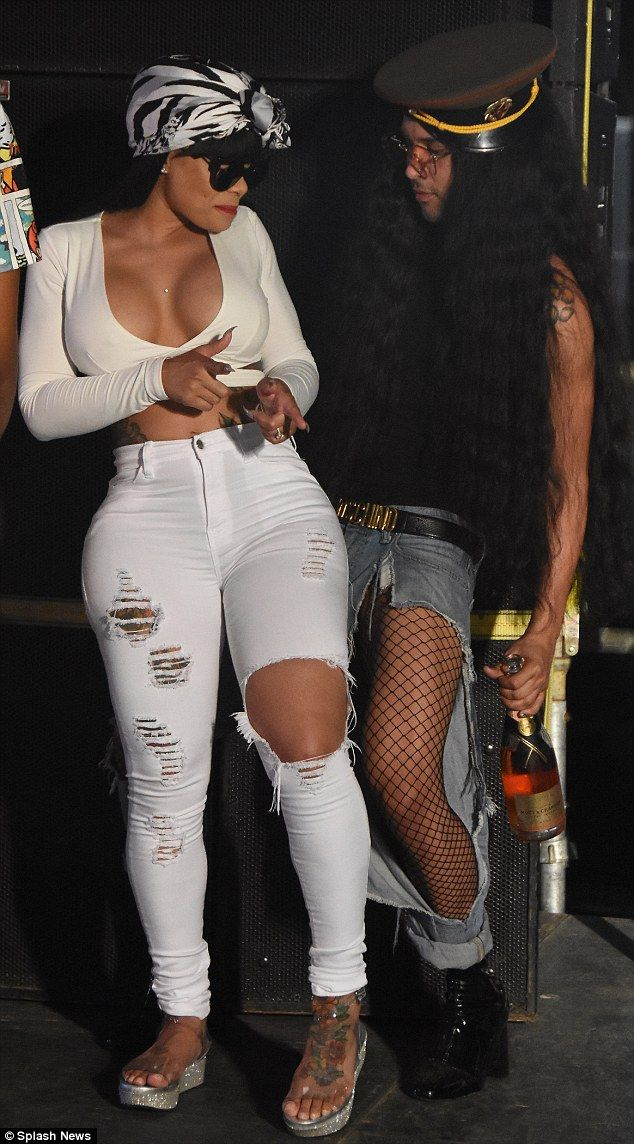In her element: Blac Chyna twerks it surrounded by male admirers in Trinidad in a photo from Wednesday