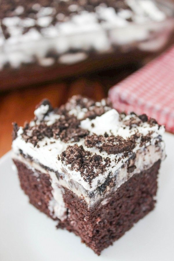 Oreo Poke Cake: America's favorite cookies are used THREE ways in this moist chocolate cake. Easy to make and always fast to disappear!